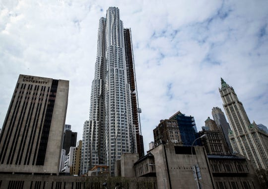 File-This photo from Friday April 15, 2011, shows the New York by Gehry tower, center, in downtown New York--which was originally supposed to include 200 sprawling condos along with 700 rentals, but now all apartments are for rent.