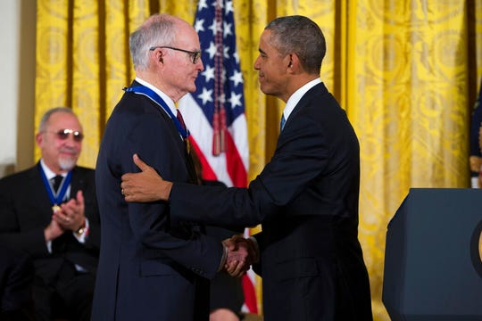 In this Nov. 24, 2015, file photo, President Barack Obama, right, shakes hands with former head of the EPA and director of the FBI William Doyle Ruckelshaus, after presenting him with the Presidential Medal of Freedom.
