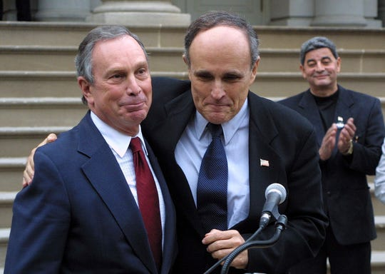 File-This photo from Saturday, Oct. 27, 2001, shows Mayor Rudolph Giuliani endorsing then Republican mayoral candidate Michael Bloomberg, left, on the steps of City Hall in New York. Saturday, Oct. 27, 2001. The Democrat-turned-Republican-turned-independent (now turned Democrat again) was unbeholden to the city's Democratic power structure or the combative law-and-order conservatism of predecessor Rudy Giuliani.