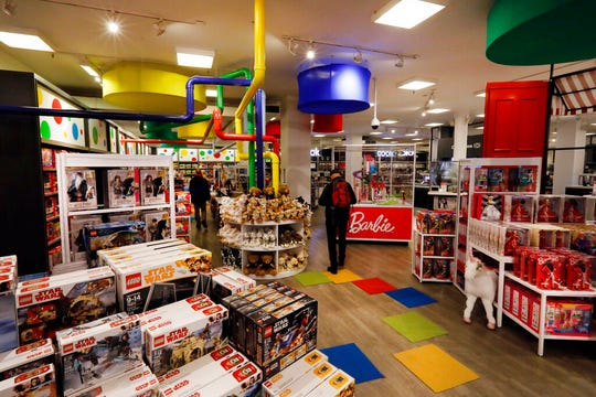 In this Nov. 5, 2019, photo shoppers browse the Fun & Games section at the Macy's flagship store in New York. On Wednesday, Nov. 27, the Commerce Department issues its October report on consumer spending, which accounts for roughly 70 percent of U.S. economic activity.