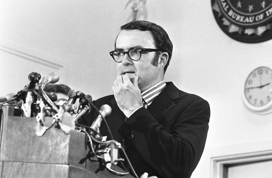 In this May 15, 1973, file photo, then-acting FBI director William Doyle Ruckelshaus pauses during a news conference in Washington.