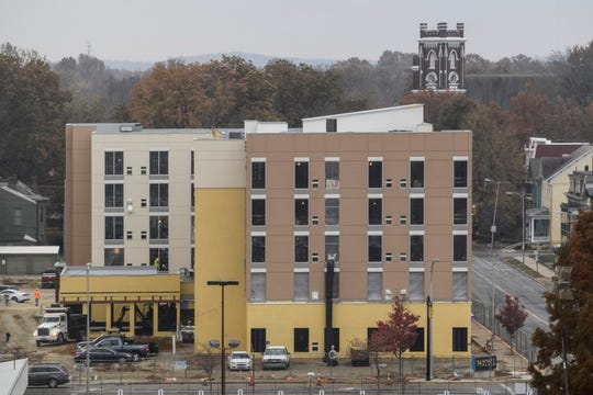 Construction crews continue building the Hyatt Place hotel at the intersection of Southeast Second and Chestnut Streets in Downtown Evansville, Tuesday, Nov. 19, 2019. The hotel was due to open soon, but the coronavirus pandemic has stalled that and put the hotel industry in dire economic straights.