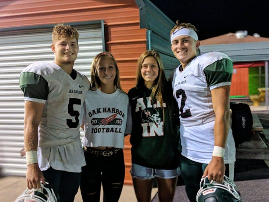 Oak Harbor's Clay Schulte, Bellevue's Cory Santoro and Casey Santoro, and Oak Harbor's Jac Alexander.