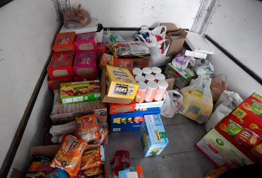 Various food items fill a trailer at St. Joseph's Catholic School in Fort Collins, Colo. on Monday, Nov. 25, 2019.