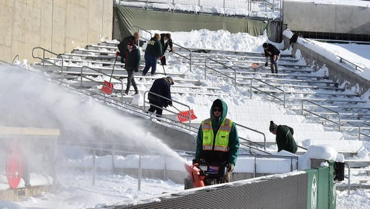 Workers clear snow from the stands and New Belgium Porch at Colorado State's Canvas Stadium on Nov. 27, 2019, in preparation for a Nov. 29 game against Boise State.