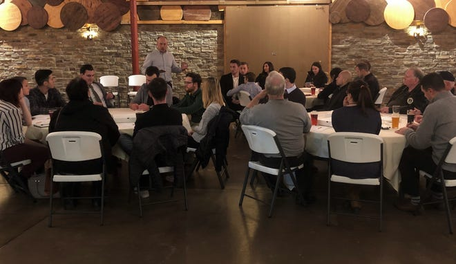 Green Bay Press-Gazette editor Mark Treinen speaks to people gathered for a listening session on the 2020 election at Badger State Brewing in Green Bay on Tuesday, Nov. 19, 2019.