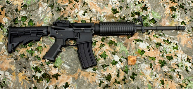 An AR-15 rifle on a generic camoflauge background
