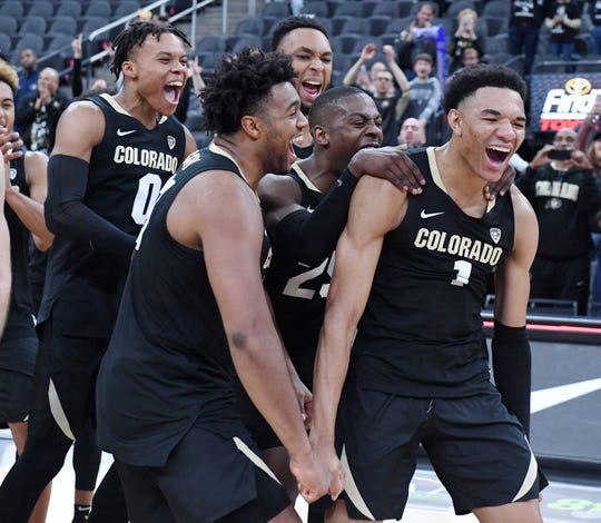 LAS VEGAS, NEVADA - NOVEMBER 26:  Tyler Bey (R) #1 of the Colorado Buffaloes is mobbed by teammates as he is announced as the tournament MVP after the team's 71-67 victory over the Clemson Tigers to win the MGM Resorts Main Event basketball tournament at T-Mobile Arena on November 26, 2019 in Las Vegas, Nevada.  (Photo by Ethan Miller/Getty Images)
