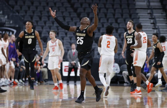 Colorado's McKinley Wright IV (25) celebrates after the team defeated Clemson 71-67 in an NCAA college basketball game, Tuesday, Nov. 26, 2019, in Las Vegas. (AP Photo/John Locher)