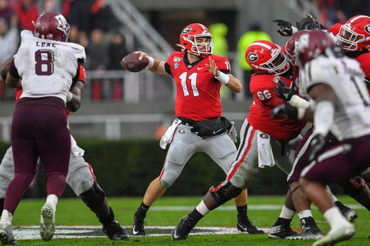 Georgia Bulldogs quarterback Jake Fromm (11) has gone the past three games completing under 50% of his passes.