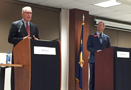 Attorney General Tim Fox, left, and state Sen. Al Olszewski discuss jobs and the economy Tuesday at a GOP gubernatorial candidates debate at Carroll College.