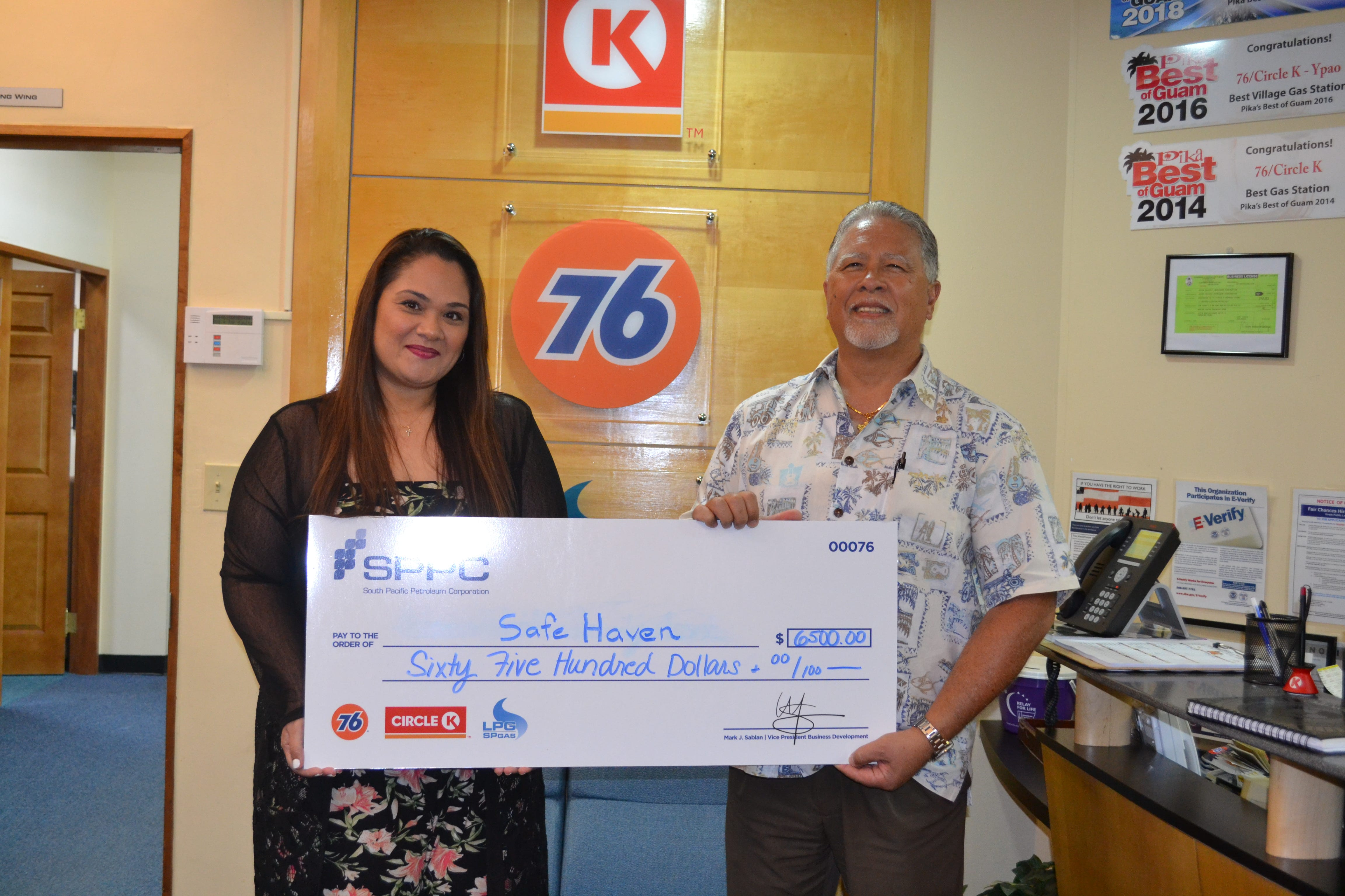 South Pacific Petroleum Corporation presented a check for $6,500 to Safe Haven Guam Pregnancy Center on Nov. 14. The proceeds were raised from SPPC's 15th annual 76 Drive for Charity Golf Tournament held Sept. 28 at the Leo Palace Golf Resort. Pictured from left: Jen Nauta, director and Mark J. Sablan, SPPC'S vice-president business development.