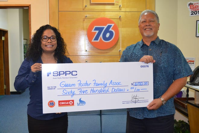 South Pacific Petroleum Corporation presented a check for $6,500 to Guam Foster Families Association, Kate Thomas Foundation on Nov. 18. Pictured from left: Kathleen Benavente, president of Kate Thomas Foundation and Mark J. Sablan.