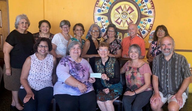The All-Island Class of 1968 presented a donation of $5,600 to Dr. Judy Flores, representing House of Chamorro on Nov. 13. This donation was made possible through the fundraising efforts of everyone who helped to implement Tesoru yan Rinikohi Siha, (treasures and collections) exhibit on Oct. 20 at the Guam Museum in Hagatna. The donations will be used to support the building of House of Chamorro in Balboa Park in San Diego, which in turn will continue to help promote information, education and awareness about the CHamoru people, the culture, history, and language for those who visit Balboa Park. From left: Mariles Benavente (AOLG), Gloria Borja (JFK), Dr. Judy Flores (HOC), Dr. Vivian Dames (JFK), Dr. Gerhard Schwab (Vivian's spouse). Back left: Marie Dela Rosa (GW), Carmelita Concepcion (AOLG), Lola Perkins (GW), Lani Nelson (AOLG), Elena Benavente (JFK), Dorothy Leon Guerrero (GW), John Salas (GW), and Patricia Wedgeworth (GW).