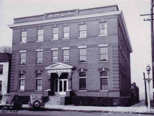 The downtown YMCA in November 1945, about the time its basement housed Henderson's first teen center beginning in late 1944. The building, erected  in 1907, was located at the southwest corner of Third and Main streets and lasted until the new YMCA on Klutey Park Plaza opened at the end of April 1973. The old building was sold in late March 1974 and was demolished in mid-July of 1976.
