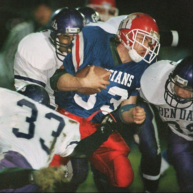 Martinsville's Israel Thompson(33)(middle) is crushed by three Ben Davis defenders during first quarter action in 1996 at Martinsville. Defending for Ben Davis is (bottom left) Jason Holok(33) and (right) Kyle Moffatt (back defender)
