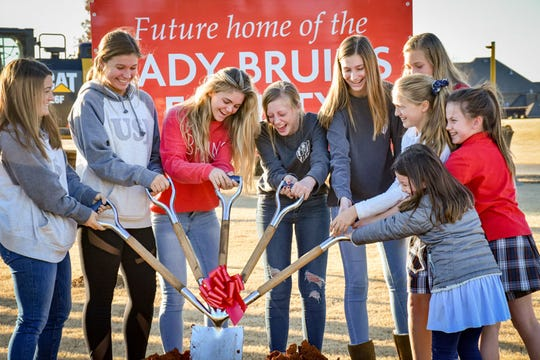 Female athletes from various teams help out in the groundbreaking at the University School of Jackson on Nov. 25, 2019.