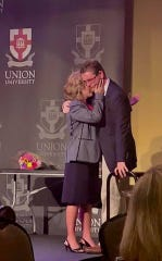 Union EDGE program graduate John Herrick gets a hug from director Jennifer Graves at their banquet last year.