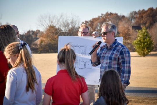 University School of Jackson Booster Club President James Kirkland speaks at the groundbreaking ceremony for the girls sports facility to be completed in 2020.