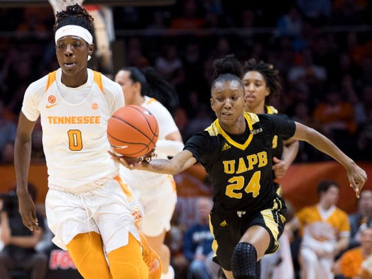 Arkansas-Pine Bluff guard Noe'll Taylor (24) knocks the ball out of the hand of Tennessee guard/forward Rennia Davis (0) during the Lady Vols' basketball game against Arkansas-Pine Bluff at Thompson-Boling Arena in Knoxville, Tenn., on Tuesday, November 26, 2019.
