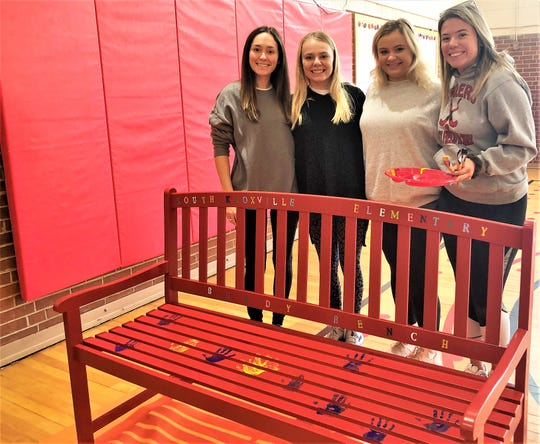 UT students and K-12 ambassadors for their nonprofit Madison Ford, Hailee Brown, Caitlyn Colley and Kellie Costello presented South Knoxville Elementary with a buddy bench and helped a group of kindergartners decorate it with their painted handprints on Nov. 25, 2019.