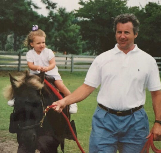 Reagan Campbell with her dad, Darby, atop her very first horse in Hilton Head, S.C., summer circa 2003.