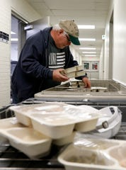 Gary Wharton, a delivery driver for Meals on Wheels of Fairfield County, sorts trays of food as he and other drivers prepare to deliver more than 2,000 meals to 800 clients Wednesday, Nov. 27, 2019, in Lancaster.