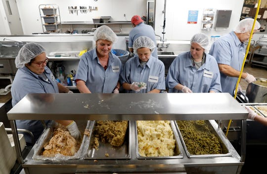 From left, Meals on Wheels of Fairfield County workers Amber Goines, Val Wiseman, Marsha White and Julie Scarberry prepare Thanksgiving meals Wednesday, Nov. 27, 2019, for the agency's clients in Lancaster. Meals on Wheels delivered about 800 meals to clients.