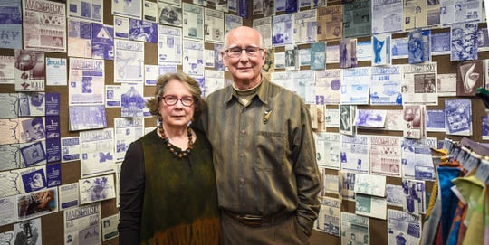Tom and Linda Dufelmeier, owners of Mackerel Sky in East Lansing, pictured Tuesday, Nov. 26, 2019, in the store's gallery.  This month, the gallery features 30 years of Mackerel Sky history, showing every bi-monthly newletter they've sent to customers about openings, featured artists, and events in their store.  They'll  close shop and retire at the end of 2019.