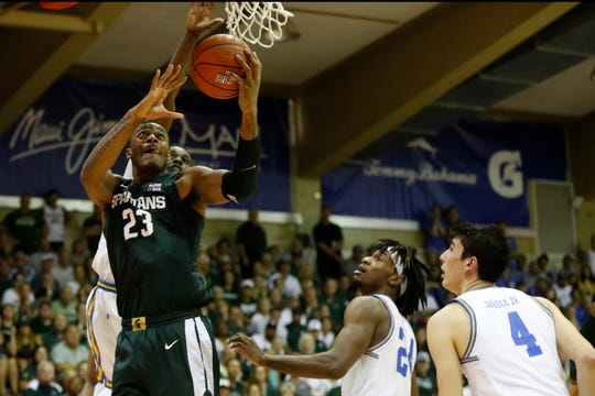 Michigan State forward Xavier Tillman (23) goes to the basket over UCLA during the second half of an NCAA college basketball game Wednesday, Nov. 27, 2019, in Lahaina, Hawaii. (AP Photo/Marco Garcia)