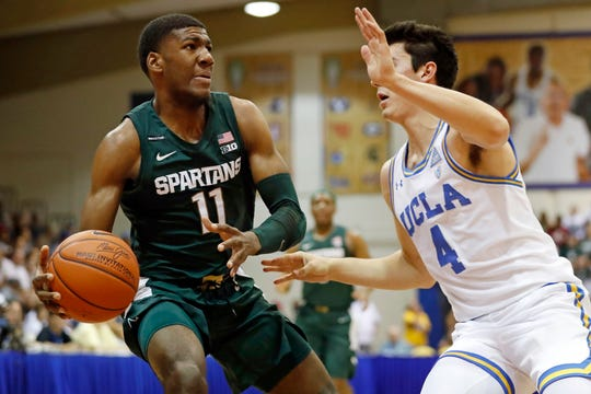 Michigan State forward Aaron Henry (11) tries to get around UCLA guard Jaime Jaquez Jr. (4) during the first half of an NCAA college basketball game Wednesday, Nov. 27, 2019, in Lahaina, Hawaii. (AP Photo/Marco Garcia)