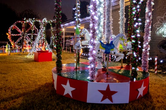 The beginnings of the Christmas light display in Clay Warling's front yard on Durbin Avenue includes a carousel, swings and a ferris wheel. Photographed Tuesday, Nov. 26, 2019, in Memphis.