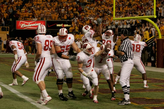 Wisconsin's Ben Strickland (3) celebrates his blocked punt touchdown in the end zone Saturday afternoon at the Metrodome. The Badgers won in a thriller, 38-34.