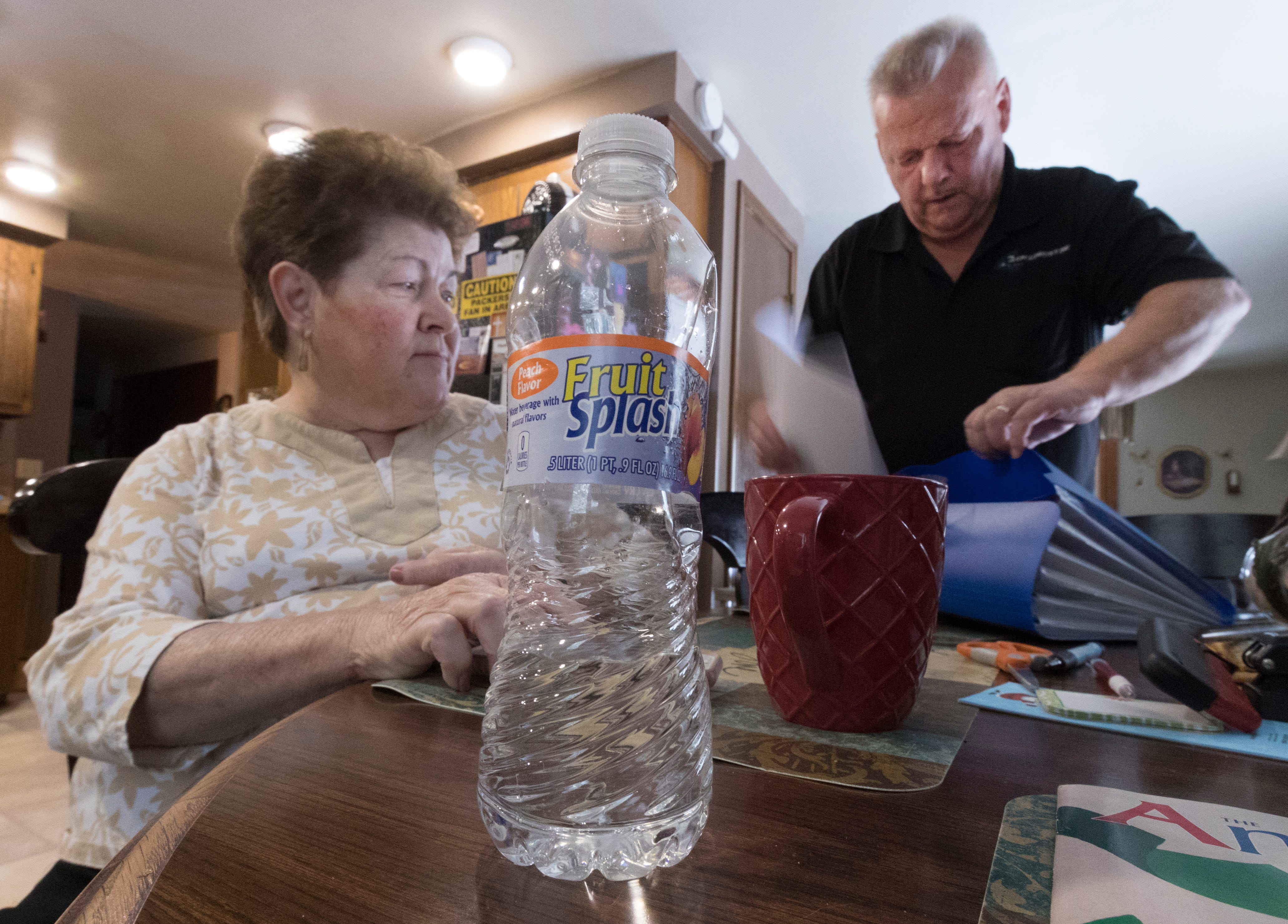 Mary Lou and Arlin Karnopp look through test results of their private well. They are pressing regulators to address drinking water contamination in Kewaunee County.