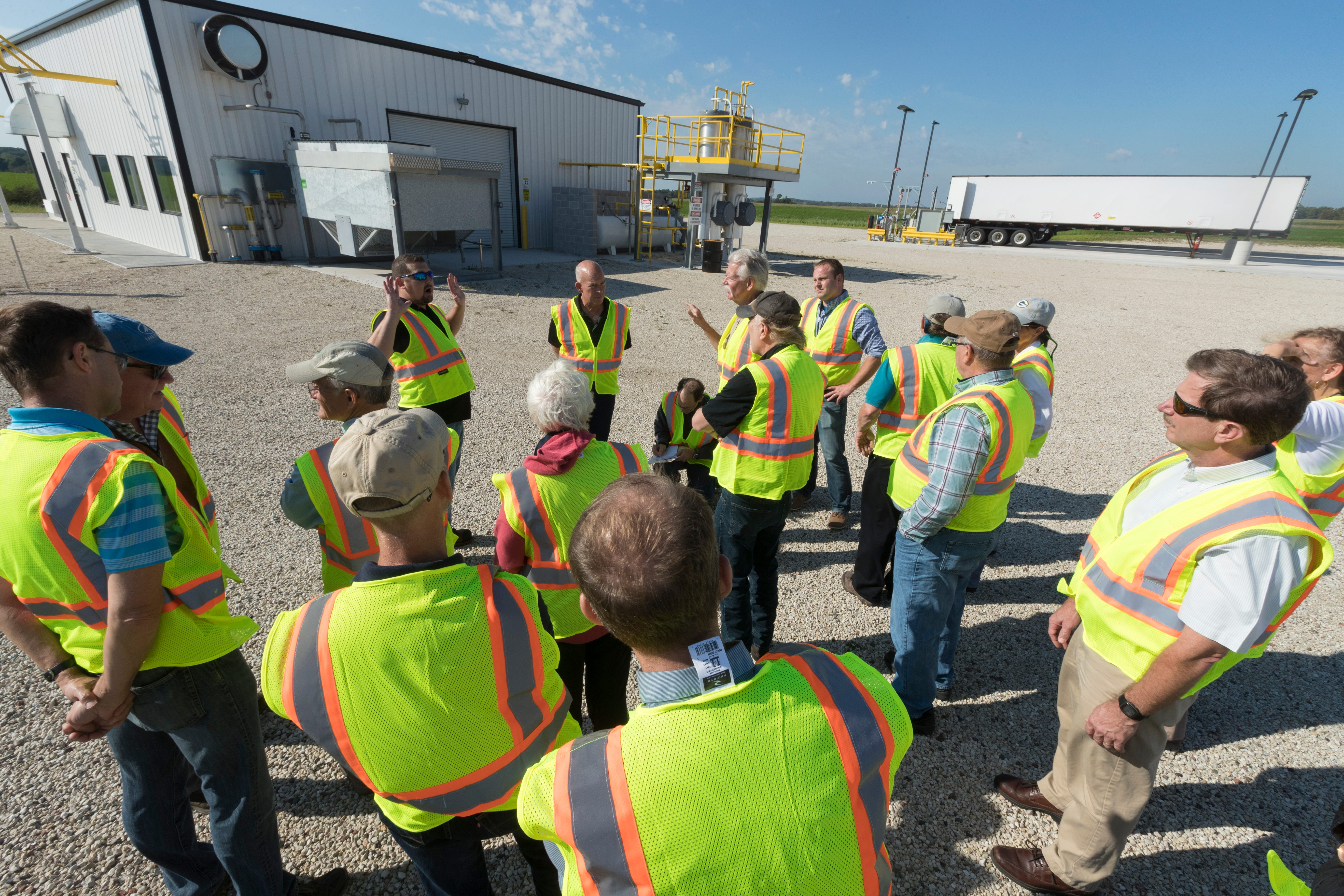 J.J. Pagel, (hands in the air) of Pagel's Ponderosa, a dairy farm, shows members of the Wisconsin Natural Resources Board a system that converts manure into methane gas.