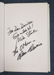 """An inscription on the inside of a book documents the time Dan Devine, the West Allis mayor, met Dan Devine, the former Packers football coach. The two met at a book-signing event in South Bend, Indiana, in the early 2000s when Devine was signing copies of his book, """"Simply Devine: Memoirs of a Hall of Fame Coach."""" The book was signed by both Devine and book contributor Mike Steele."""