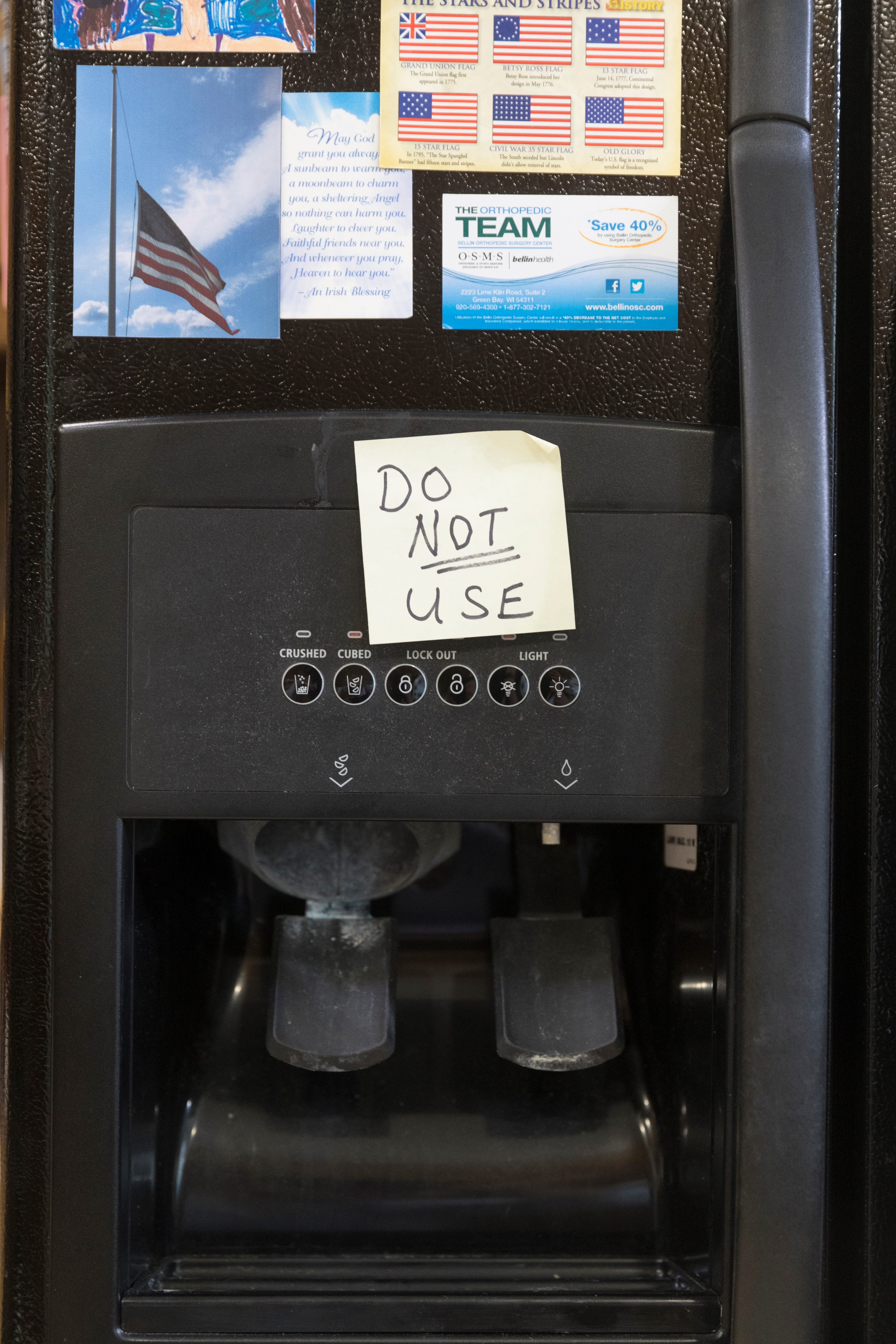Arlin and Mary Lou Karnopp have a reminder on their refrigerator's water dispenser not to use it.