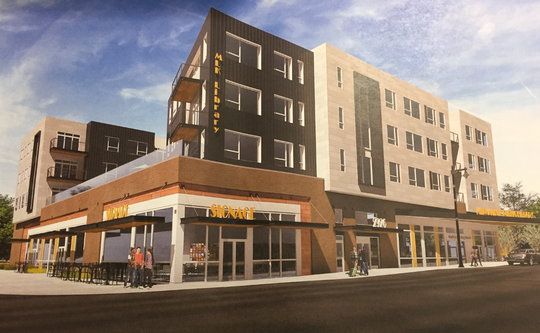 A new library branch, with apartments on the upper floors, is being proposed for the corner of North King Drive and West Locust Street
