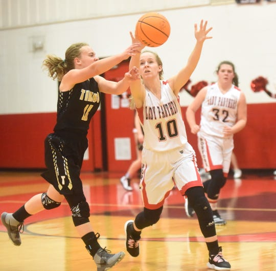 Norfork's Aeja McFall steals the ball against Timbo on Tuesday night.