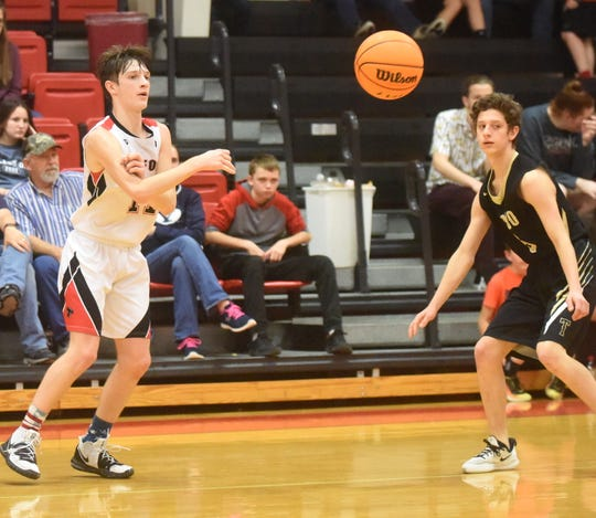 Norfork's Blythe Stapleton passes during the Panthers' game against Timbo on Tuesday night.