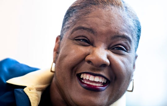 Montgomery Regional Airport employee Shirley Rogers laughs and smiles as she works at the airport in Montgomery, Ala., on Wednesday, November 27, 2019.