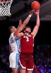 Nov 27, 2019; Nassau, BHS; North Carolina Tar Heels forward Garrison Brooks (15) and Alabama Crimson Tide forward Alex Reese (3) go for the ball during the second half at Imperial Arena. Mandatory Credit: Kevin Jairaj-USA TODAY Sports
