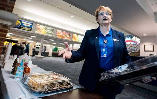Montgomery Regional Airport employee Alice Sewell sets out holiday cookies for passengers at the airport in Montgomery, Ala., on Wednesday, November 27, 2019.