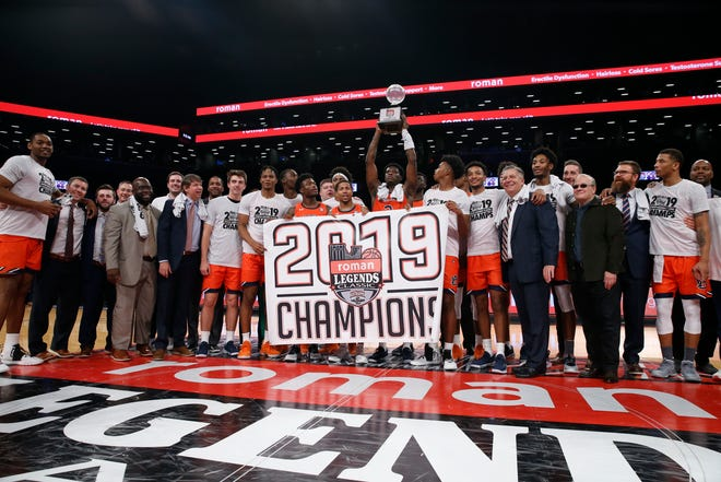 Auburn celebrates after winning the Roman Legends Classic against Richmond at Barclays Center on Nov. 26, 2019, in Brooklyn, NY.