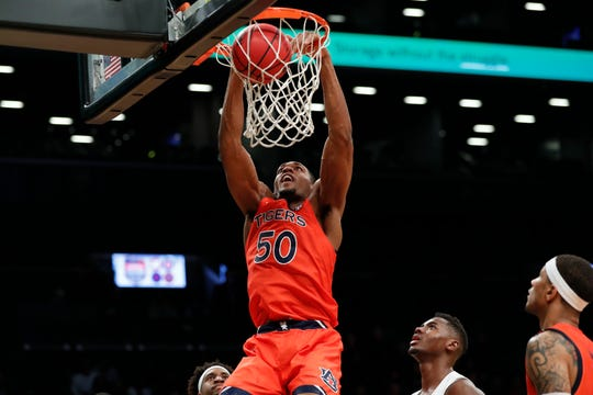 Auburn center Austin Wiley (50) dunks with no resistance in the second half of an NCAA college basketball game against Richmond in the Legends Classic, Tuesday, Nov. 26, 2019, in New York. Auburn defeated Richmond 79-65. (AP Photo/Kathy Willens)