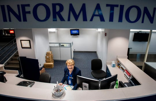 Montgomery Regional Airport employee Alice Sewell works the information booth at the airport in Montgomery, Ala., on Wednesday, November 27, 2019.