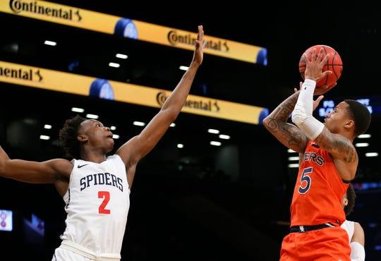 Auburn guard J'Von McCormick (5) shoots over Richmond forward Souleymane Koureissi (2) at the Legends Classic in Brooklyn on Nov. 26, 2019.