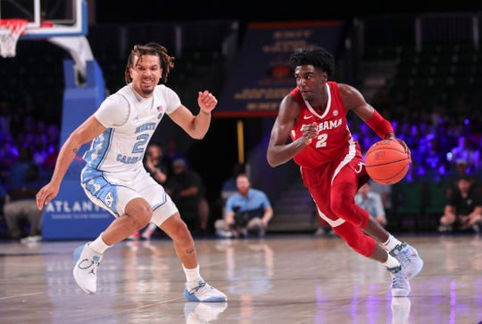 Nov 27, 2019; Nassau, BHS; Alabama Crimson Tide guard Kira Lewis Jr. (2) dribbles as North Carolina Tar Heels guard Cole Anthony (2) defends during the first half at Imperial Arena. Mandatory Credit: Kevin Jairaj-USA TODAY Sports