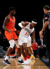 Auburn forward Danjel Purifoy (3) defends Richmond guard Blake Francis (1) at the Legends Classic in Barclays Center on Nov. 26, 2019, in Brooklyn.