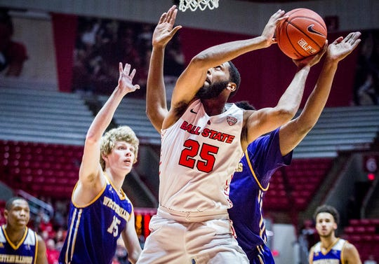 Ball State's Tahjai Teague shoots past Western Illinois' defense during their game at Worthen Arena Tuesday, Nov. 26, 2019. Western Illinois defeated Ball State 69-62.